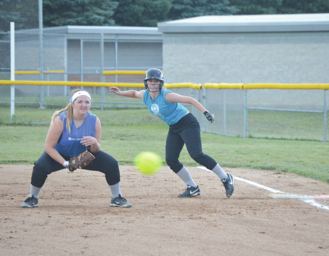 Players for MWZ Financial Group (left) and American Legion Post 763 follow the ball, during Monday's Dayton South Fastpitch Softball League girls high school 18U game on the Coy Middle School softball diamond in Beavercreek. MWZ Financial won the game, 10-7.