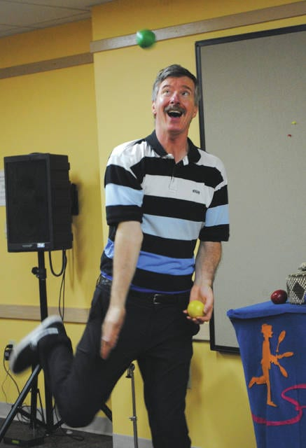 Whitney Vickers | Greene County News Tom Sparough, otherwise known as The Space Painter, made two presentations at the Fairborn Community Library June 13 in which he practiced various juggling techniques.