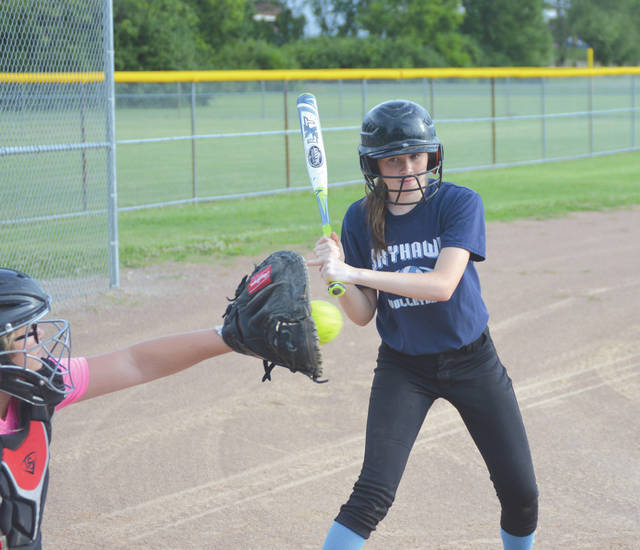 A batter for the Fairborn-based Total Drama Fastpitch girls 16U team looks at a strike, during practice June 22 at Fairfield Park in Fairborn. Not to worry though, the same batter smacked a triple on the next pitch.