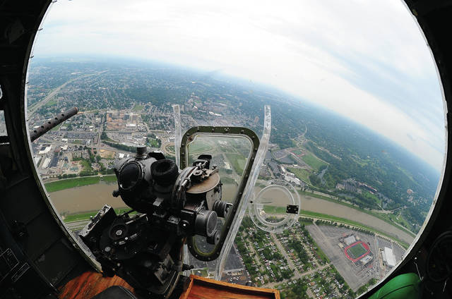 Mike Ullery | Daily Call The best seat in the house … the view from the bombardier's position in the nose of Madras Maiden, a World War II B-17 Flying Fortress in the sky over Dayton on Monday. Madras Maiden will be giving rides out of Stevens Aviation, 3500 Hanger Drive at the Dayton International Airport on July 15-16. Flights will be from 10 a.m. to 2 p.m., on the hour both days. Cost is $450 per person. Ground tours will be held from 2:30 to 5:30 p.m. both days. There is no charge for ground tours but donations will be accepted. Those wishing to fly are encouraged to make advance reservations by calling 918-340-0243.
