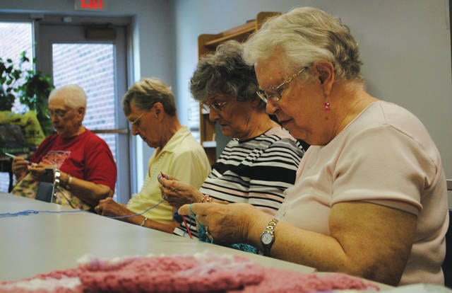 Whitney Vickers | Greene County News The Fairborn Senior Center hosts a weekly knitting and crocheting group, The Happy Hookers, who donate their hand-made creations to Soin Medical Center, local homeless shelters and the Kettering Health Network NICU.