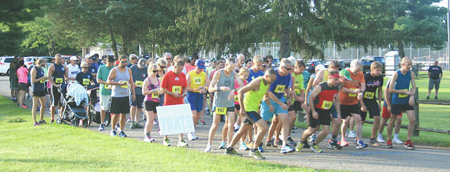 File photo Runners take the starting line at the 2016 Fairborn 5K.