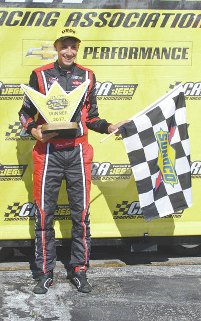 Carson Hocevar, the winner of the inaugural Gem City 100 CRA All-Star Series race, July 9 at Kil-Kare Raceway in Xenia, poses with his winner's trophy. Hocevar, 14, of Portage, Mich. became the youngest driver to win a Jeg's CRA All-Star Series event, edging Wheeling, W.Va. driver Travis Braden by 1.416 seconds.