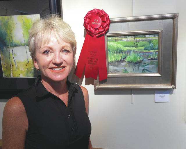 """Susie King, """"Wetlands 2,"""" earned second place."""