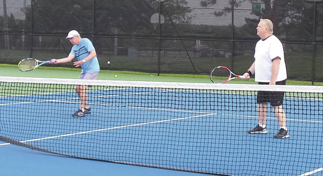 The Division B doubles tandem of Terry Miller (left) and Keith Taylor, both of Fairborn, claimed a 6-7 (4-7), 6-2 split with the team of Tim and Mary Poth, of Beavercreek in a make-up match July 5, on Fairborn's Community Park tennis courts.