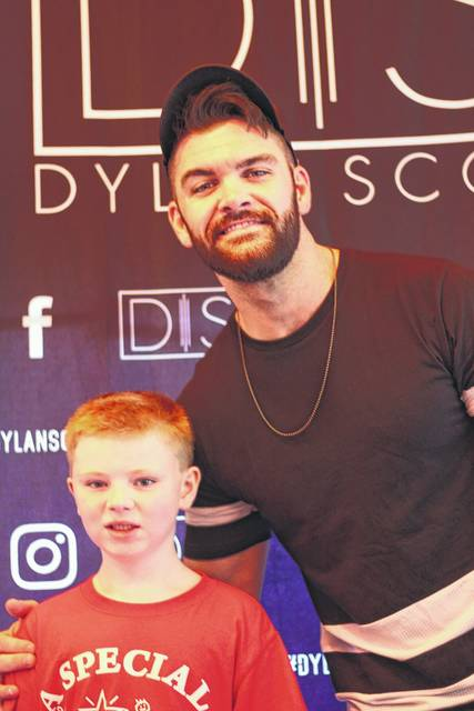 Brycen Marshall, 7, of Xenia, met his favorite singer, Dylan Scott, July 28 at the Shelby County Fair. The meet and greet was arranged by A Special Wish Foundation of Dayton. Brycen is the son of Nicole and Ben Marshall.