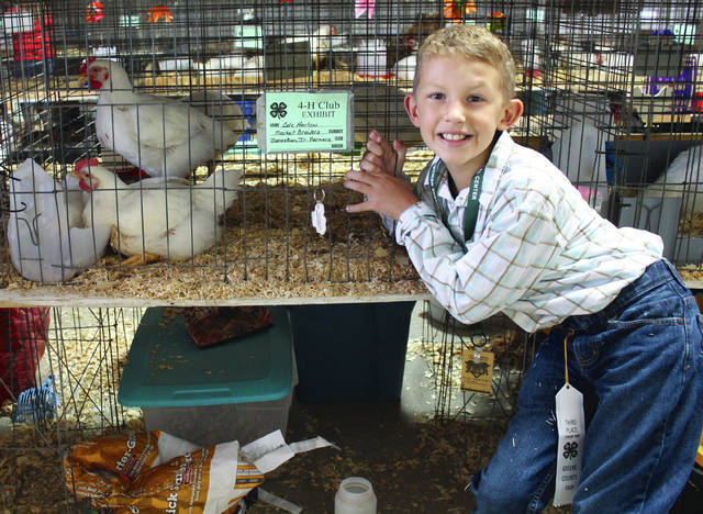 Cole Harlow of Jamestown Jr. Farmers 4-H Club earned a third place ribbon. This was his first year showing chickens.