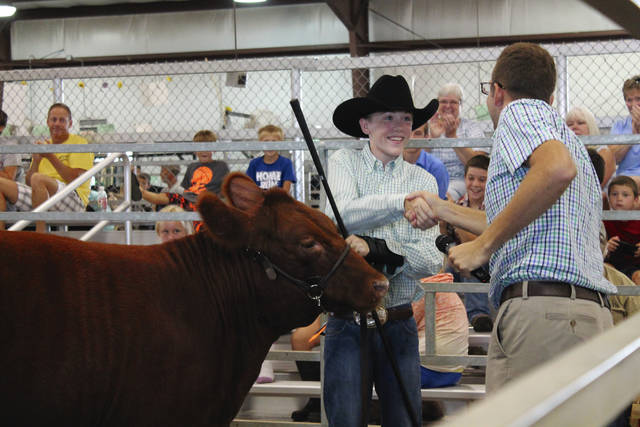 Brandon Barr shakes hands with Judge Levi Richards after he earns second place and a feather in his hat.