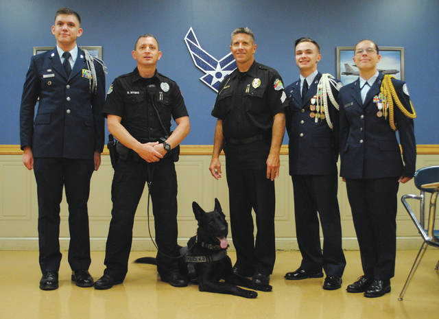 Whitney Vickers | Fairborn Herald Fairborn High School JROTC students, Nikko and his handler Officer Rod Myers and Fairborn Police Sergeant Willard Watts.