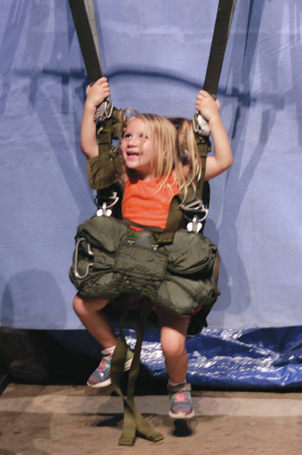 Visitors were encouraged to try on an authentic parachute and take a ride in a B-2 bomber ejection seat.