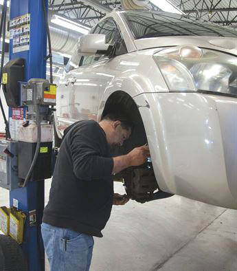 Submitted photo David Horton, auto mechanic, checks the brake pads during a vehicle inspecvtion. Ensuring tires, brakes, and other systems meet factory specifications is important to ensure safe driving throughout the winter.