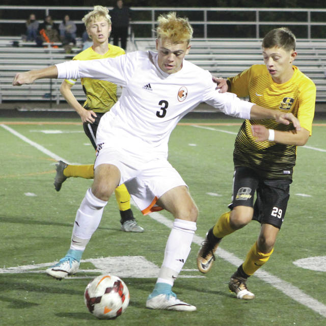 Beavercreek senior midfielder Cameron Ryan (3) gets control of the ball as Sidney senior forward Thomas Atwood (29) defends, during an Oct. 17 boys Division I high school sectional soccer tournament match at Beavercreek High. The host Beavers won the match, 9-0 to advance. Beavercreek will host Stebbins at 7 p.m. Saturday, Oct. 21 for their next match.