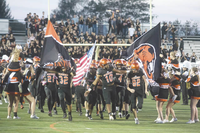 Beavercreek, shown here charging onto the field prior to the team's win over Miamisburg, can still make the playoffs. However, they will have the tough task of defeating undefeated and state-ranked Centerville, and getting help from other teams, in order to get there.