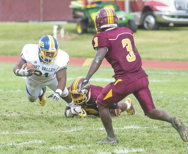 Central State freshman linebacker Mikey'ion Hunter brings down Fort Valley State senior running back Chauncy Jackson with a leg tackle, during Saturday's Oct. 21 Southern Intercollegiate Athletic Conference college football game at William Patrick McPherson Memorial Stadium in Wilberforce.