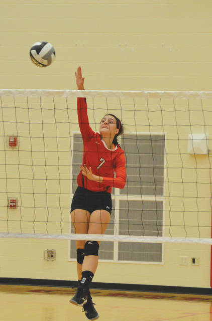 Sara Beste (7), shown here in a win against conference rival Greeneview earlier this season, jammed a finger early on in Tuesday's volleyball match with Fairlawn, but she and the rest of the Cedarville girls high school team rallied to the Division IV sectional tournament win, Oct. 17 at Troy High.