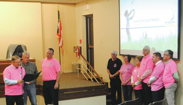 Whitney Vickers | Fairborn Daily Herald Fairborn Mayor Dan Kirkpatrick proclaimed October as Pink Medic Month during the latest meeting Oct. 2. Firefighters and Paramedics John Howard and Scott Six were present to accept the proclamation. Council members also dawned shirts promoting breast cancer awareness.