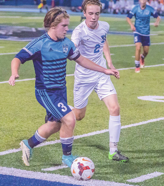 Xenia sophomore midfielder Zach Stefan (2) closes in on Fairborn sophomore midfielder Keegan Dierker, in first-half action of an Oct. 10 boys high school soccer match at Xenia's Doug Adams Stadium. The two teams played to a 2-all tie, enabling the host Buccaneers to win the Greater Western Ohio Conference, American South division title.