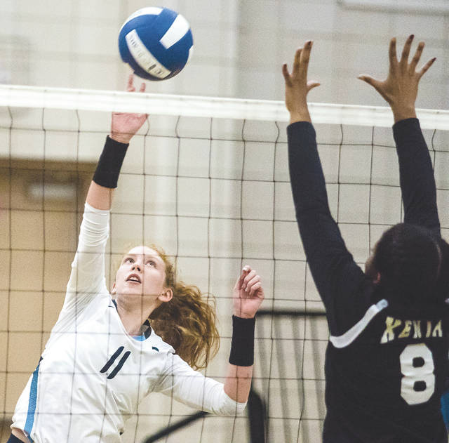 Fairborn senior Kayleigh Finlayson tips the ball over Xenia senior middle hitter Kristina White, during Thursday's Oct. 12 girls high school volleyball match at Xenia High. Finlayson recorded a match-best 11 kills to lead Fairborn to a straight-set win and its first-ever GWOC divisional title.