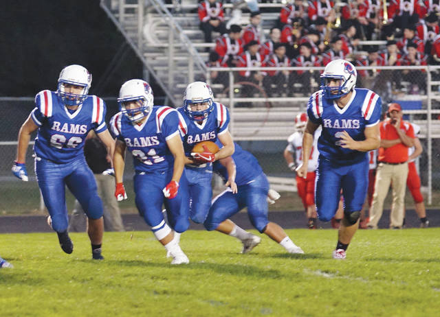 A Greeneview ball carrier follows a convoy of Rams blockers for a gain in Friday's Oct. 13 high school football game against Cedarville at Don Nock Field. Greeneview fell out of the Region V computer points standings for the first time this season, despite the win.