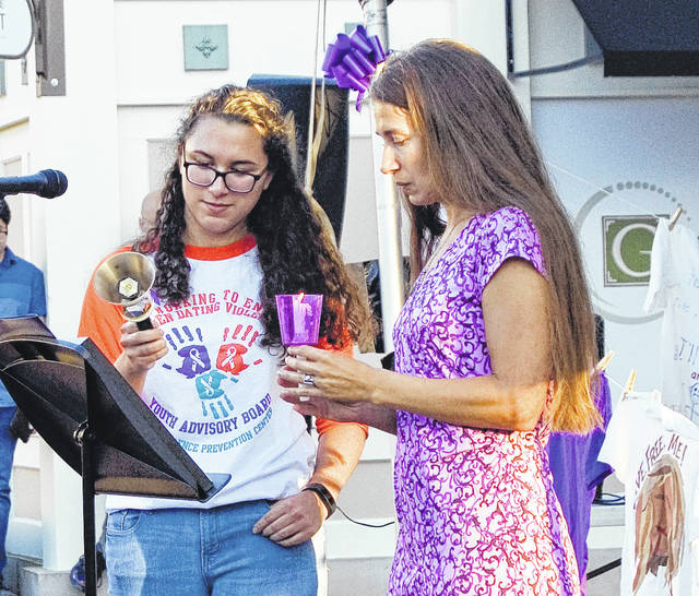 Submitted photos Family Violence Prevention Center officials and members of the community gathered Oct. 1 at the Greene to light candles and remember victims of domestic violence.