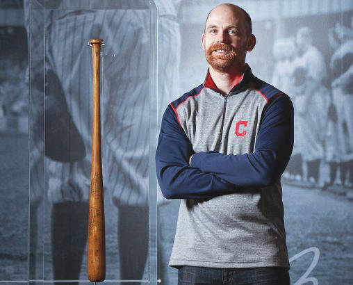 Submitted photo 2010 Wright State grad Jeremy Feador has a front-row seat as Cleveland Indians chase history. He is pictured with the famous Bob Feller bat Babe Ruth leaned on during a ceremony shortly before he died.