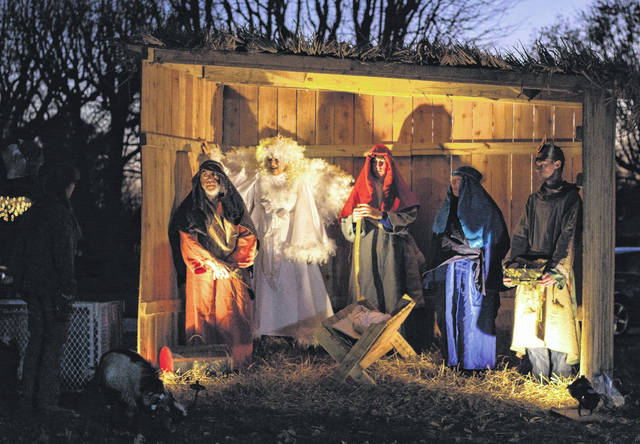 The event also featured a live nativity scene, complete with animals including goats and a donkey.