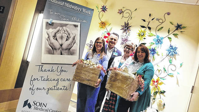 Submitted photo Andrea Carr and Darla Baker (holding baskets) were recently recognized as certified midwives at Soin Medical Center Maternity.