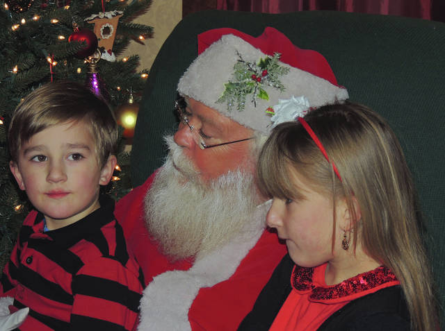 Submitted photos Mr. and Mrs. Santa Claus will be greeting the youngest park patrons at Santa's Holiday in the Park.