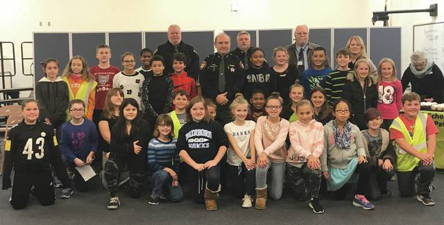 Submitted photos AAA Miami Valley and Fairborn Intermediate School Safety  Patrol members recognized Greene County Sheriff Gene Fischer by presenting  him ...