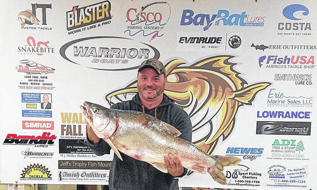 Submitted photos James Beres displays his new Ohio record Lake Trout.