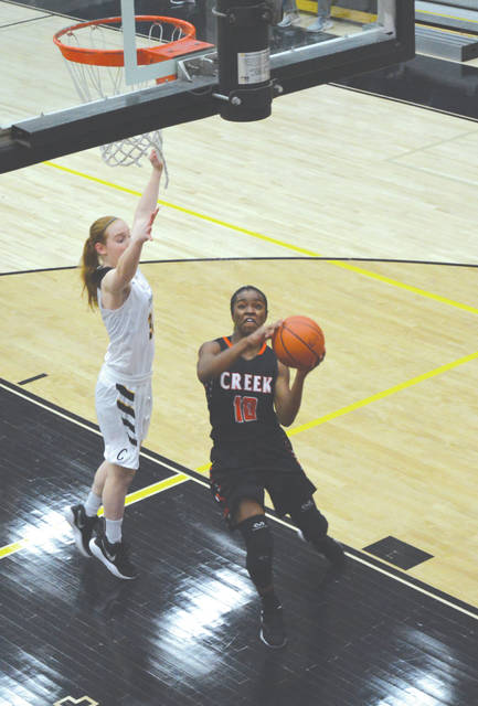 Beavercreek senior guard Carmen Williams drives in for a first-half score in Saturday's 45-34 Dec. 16 road win over Centerville. Williams led the Battlin' Beavers with 19 points scored in the win.