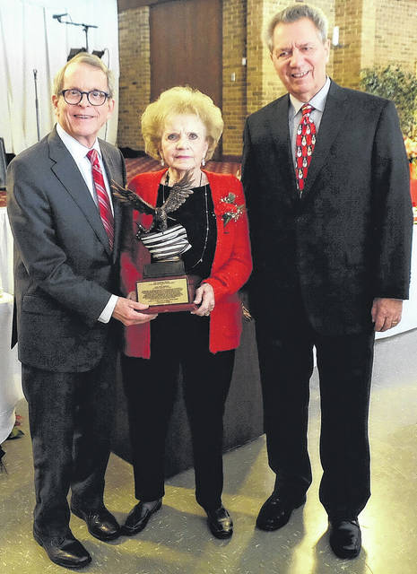 Submitted photo Attorney General Mike DeWine receives American Nationalities Movement Freedom Award from past president Irene Morrow and current president Ralph Perk Jr.