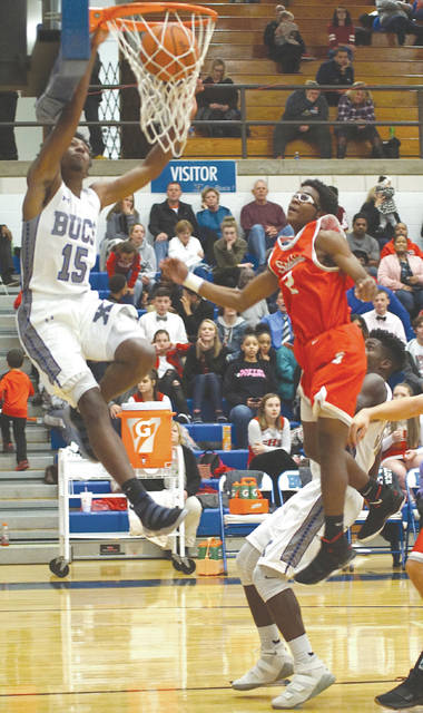 Samari Curtis (15) scores on a slam dunk Dec. 8 in a 90-65 Xenia win over Stebbins. Curtis, a junior, currently leads the Greater Western Ohio Conference in scoring with a 30.5 points per game scoring average.