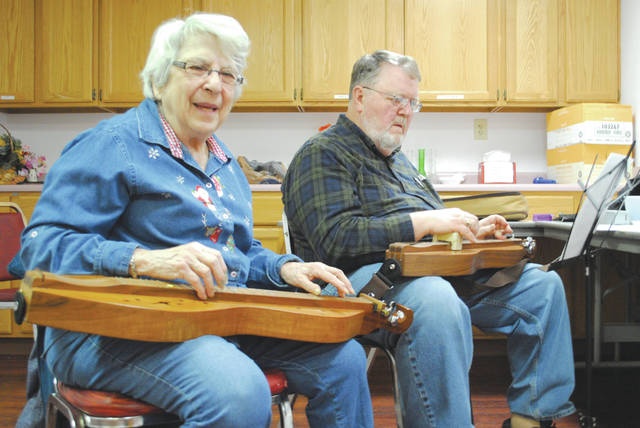 Whitney Vickers | Fairborn Herald Long-time dulcimer and piano player Joni Sines offers dulcimer lessons each Monday at the Fairborn Senior Center. She is pictured alongside student Warren Brown, who has been playing the instrument for five years.
