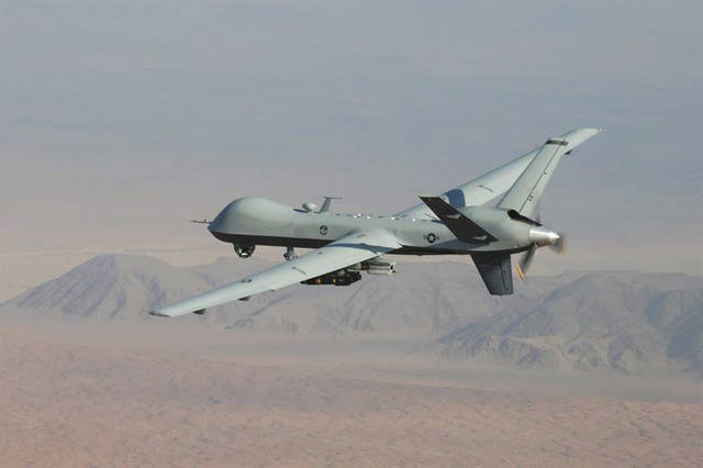 Submitted photo An MQ-9 Reaper, armed with GBU-12 Paveway II laser guided munitions and AGM-114 Hellfire missiles, piloted by Col. Lex Turner flies a combat mission over southern Afghanistan.