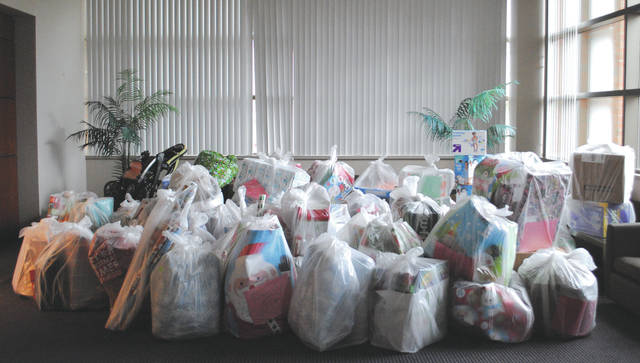 Whitney Vickers | Fairborn Herald Wright State University participated in Greene County Adopt-A-Family, assisting 25 family or more than 130 individuals in need.
