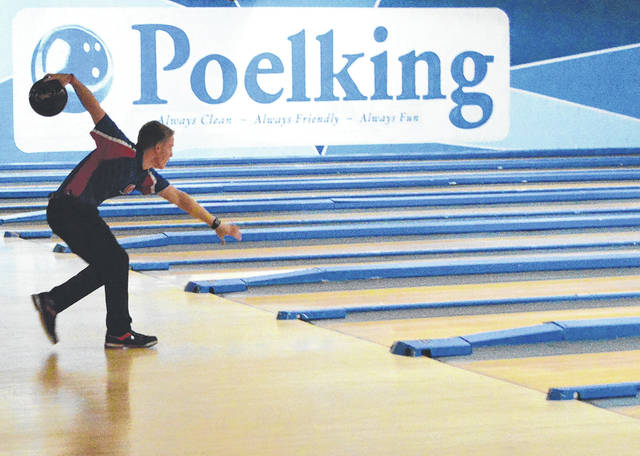 Carroll boys varsity team captain Jacob Schoening throws a warm-up ball prior to the Patriots' Jan. 30 match with Greater Catholic League Co-ed foe Purcell Marian, at Poelking Lanes in Dayton.