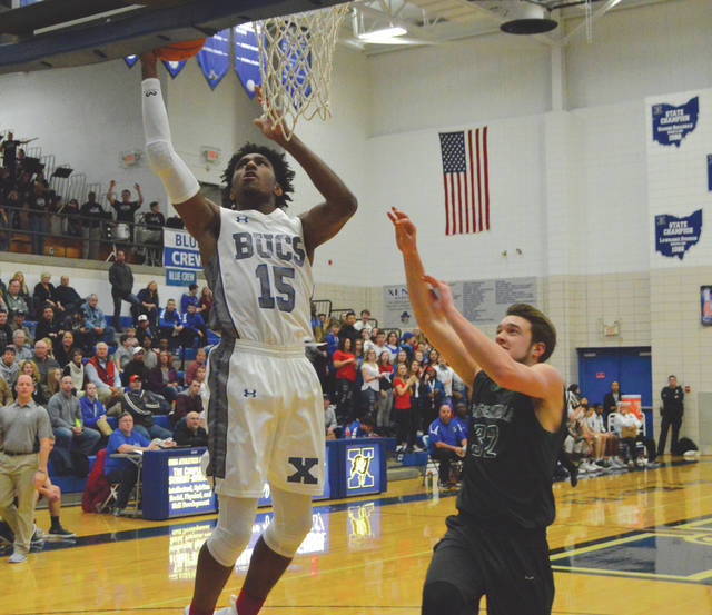Samari Curtis goes in for two of his game-high 34 points in Xenia's 92-76 win over Greenville, Jan. 19 at Xenia High.