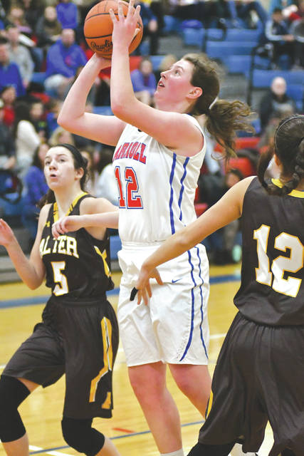 Carroll sophomore forward Julia Keller (21) puts up a shot between Alter defenders Kala Gillis (5) and Julia Paley (12) in Wednesday's Jan. 10 win in Riverside. The Patriots ended a nine-game losing streak to Alter with a 43-26 win.