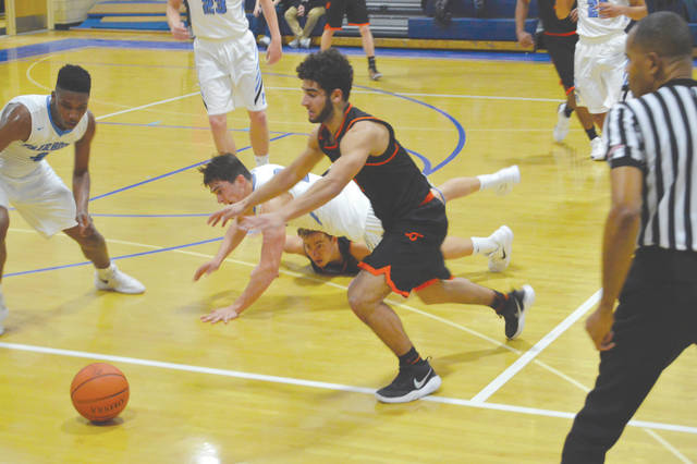 Fairborn and Beavercreek players dive for a loose ball, during the second half of Tuesday's Greater Western Ohio Conference basketball game in the Baker Middle School gymnasium in Fairborn. The host Skyhawks got the loose ball, but Beavercreek escaped with a 51-49 win.