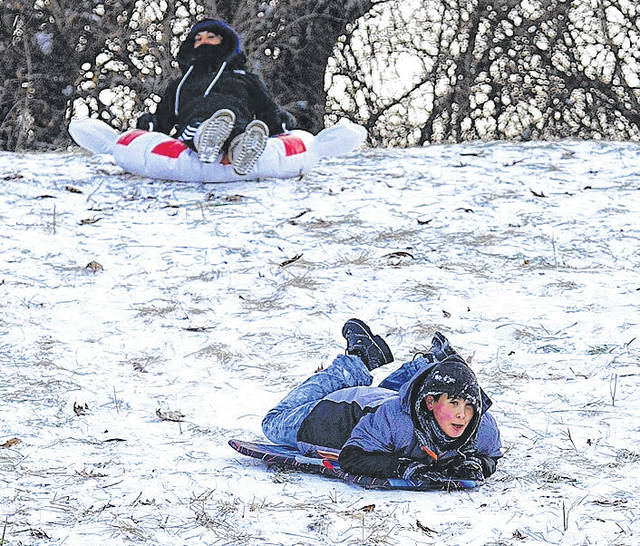 Barb Slone | Fairborn Daily Herald Several children got a chance to enjoy the winter snow at Hawkins Hill on Fairgrounds Road recently. The cold didn't stop them from speeding down the hill.