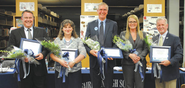 Whitney Vickers | Fairborn Herald The Fairborn City Schools Board of Education was recognized at the Jan. 11 meeting after the Ohio School Board Association declared January as School Board Recognition Month. Members of the FCS Board of Education, including (pictured from left to right) member Jerry Browning, Vice President Katie Mlod, President Andrew Wilson, member Mary Reaster and member Pat McCoart, received flowers and a certificate in honor of their service. The City of Fairborn also proclaimed the week of Jan. 21-Jan. 27 as Fairborn Public School Week at the Jan. 16 council meeting, in which Wilson was present to accept.