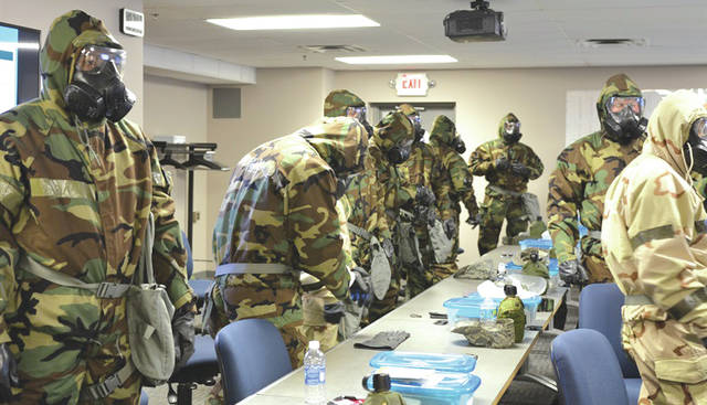 Submitted photo Members complete weapons qualifications in preparation for deployment at the Combat Arms Training and Maintenance facility at the 88th Security Forces Squadron on Wright-Patterson Air Force Base.