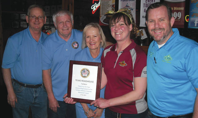 Submitted photo Pictured from left to right are committee officials and members Dan Kirkpatrick, Terry Burkert and Karen Nagafuchi presenting their gratitude to Shauna Cunningham and Lance Walker of Texas Roadhouse Fairborn.