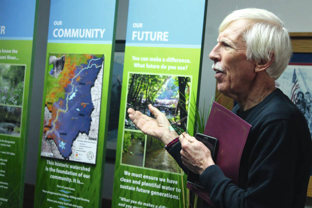 Anna Bolton | Greene County News Bill Schieman from Little Miami Watershed Network presents a new display in celebration of the 50th anniversary of the signing of the Ohio Scenic Rivers Act.