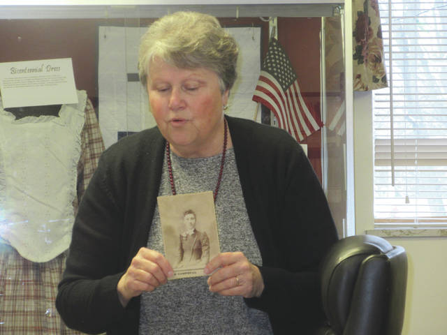 Submitted photo Marie Reedy explaining how to date old family photos at the February Rebecca Galloway Chapter DAR meeting.