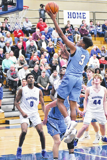 Fairborn's Shaunn Monroe (3) glides to the basket for a first-half score on Feb. 13 in a boys high school basketball game at Miamisburg. A late scoring run enabled Miamisburg to rally for a 62-56 win.