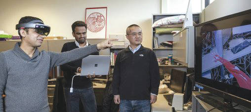 Graduate researchers Ashutosh Shivakumar, Miteshkumar Vasoya and Yong Pei, associate professor of computer science and engineering, developed the augmented-reality technology in Wright State's SMART (Sustainable – Mobile – Autonomous – Real Time – Translational) Lab.