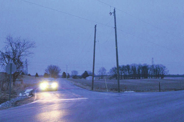 Linda Collins | Greene County News Two Ohio Edison poles at the intersection of Herr Road and State Route 235.