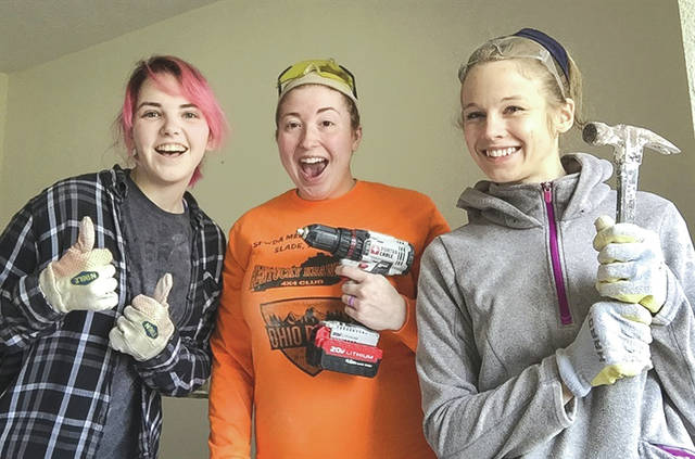 Submitted photo From left: Dixie Champagne, Kaylee Bowers, and Hannah Wegner, along with other members of the Wright-Patterson Air Force Base chapel community traveled to the Houston, Texas, for a week in January to help restore homes devastated by Hurricane Harvey, which hit the area in late August, 2017.